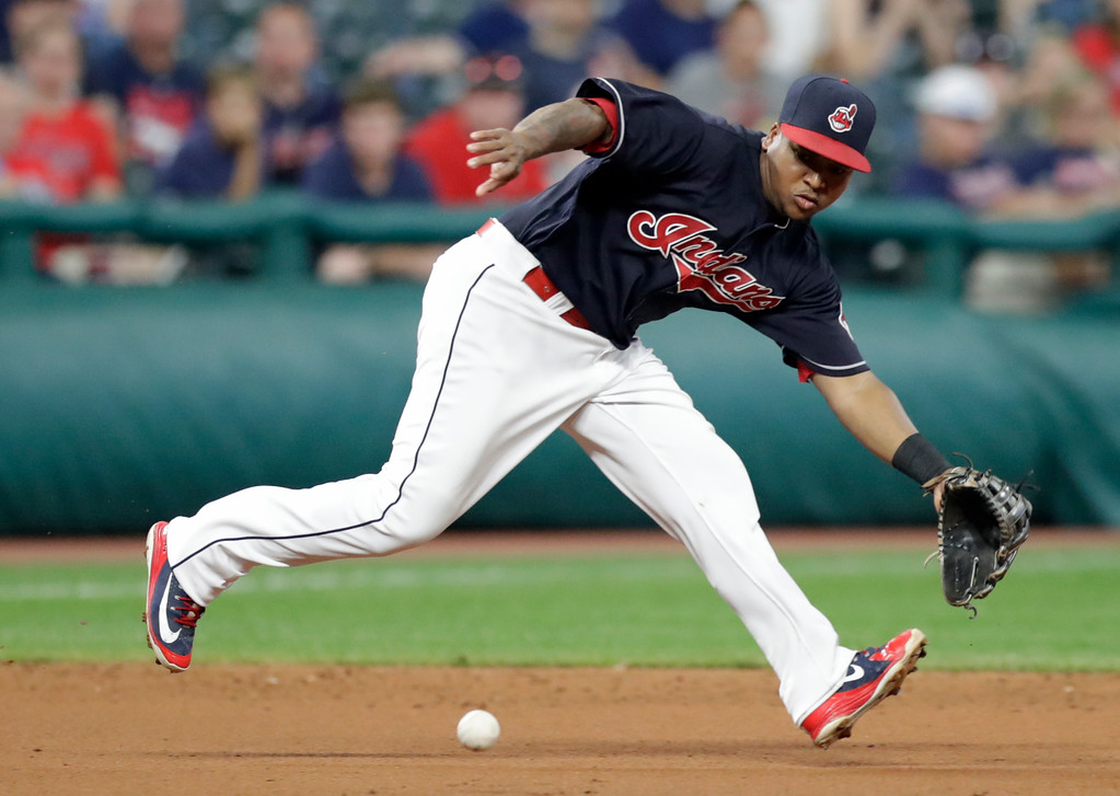 . Cleveland Indians\' Jose Ramirez fields a ball hit by Kansas City Royals\' Jorge Bonifacio during the seventh inning of a baseball game Tuesday, Sept. 4, 2018, in Cleveland. Bonifacio was safe at first base when a play was made at another base. (AP Photo/Tony Dejak)
