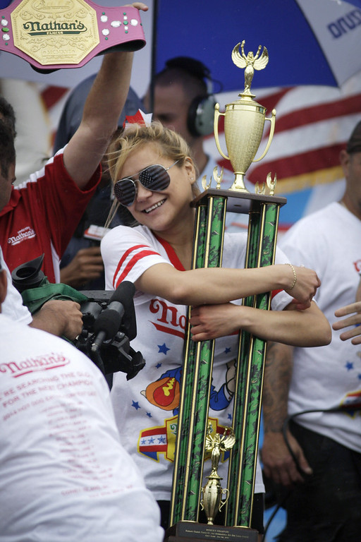 . Miki Sudo wins the women\'s division of the Nathan\'s Famous Hot Dog Eating Contest at Coney Island on July 4, 2014 in the Brooklyn borough of New York City.  Sudo beat reigning champion Sonya Thomas by eating 34 hot dogs in 10 minutes. Joey Chesnut won his eighth straight Nathan\'s Hot Dog Eating Contest with 61 hot dogs. (Photo by Kena Betancur/Getty Images)