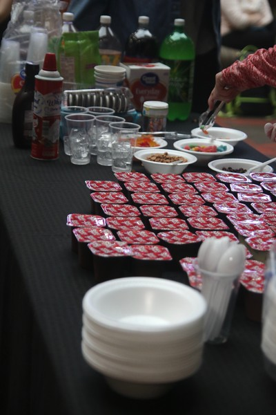 Students from the class hosting the party served pudding with toppings because that is the main character's favorite snack.