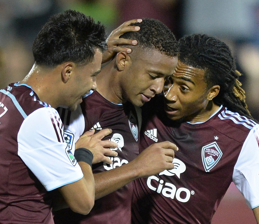 . Carlos Alvarez, left, and Marlon Hairston, right, congratulated Gabriel Torres, center, following his goal in the second half. The Colorado Rapids defeated Chivas USA 3-0 at Dick\'s Sporting Goods Park Friday night, July 25, 2014. Photo by Karl Gehring/The Denver Post