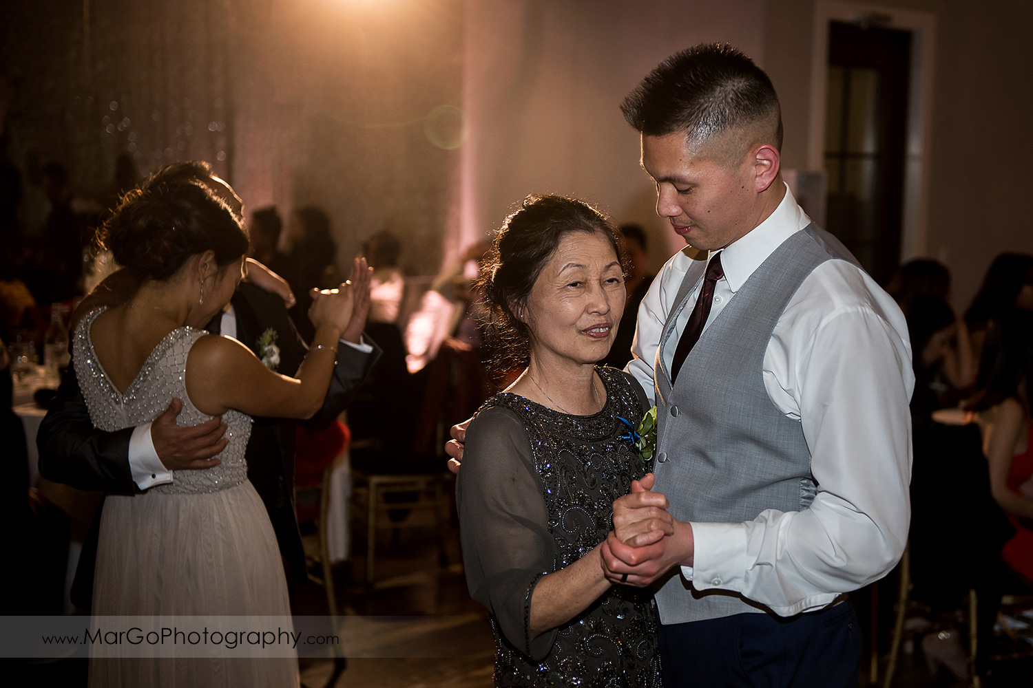 groom with mother during parents dance at Sunol's Casa Bella wedding reception