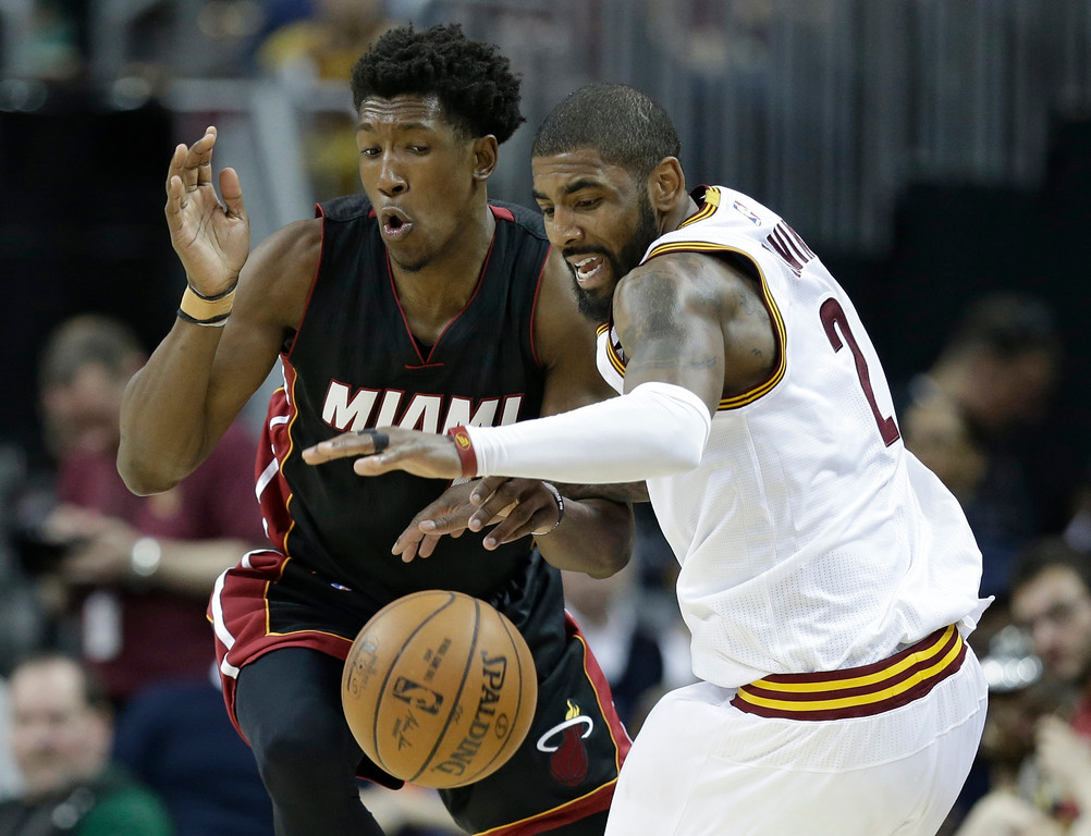 . Cleveland Cavaliers\' Kyrie Irving, right, drives against Miami Heat\'s Josh Richardson in the second half of an NBA basketball game, Monday, March 6, 2017, in Cleveland. The Heat won 106-98. (AP Photo/Tony Dejak)