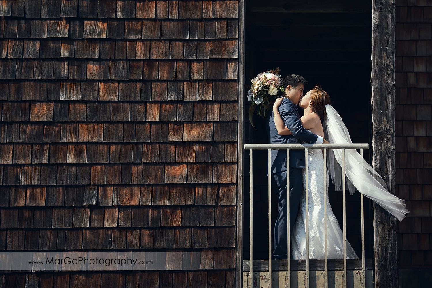 bride and groom kissing at the University of California, Santa Cruz
