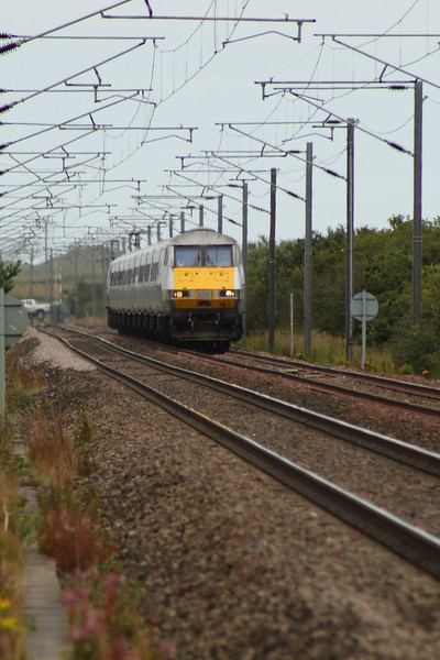 DVT 82210 at the head of an East Coast service heading South as seen from West Goswick Farm LC. In the background is Goswick LC which is the site of the former Goswick station