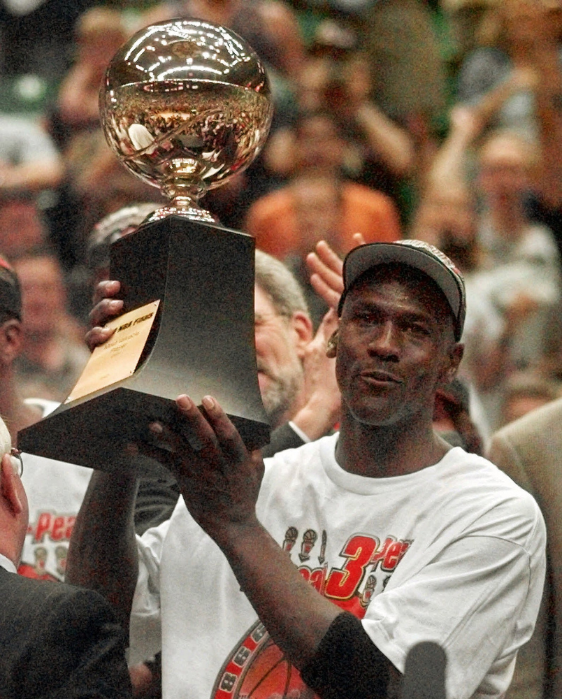 . Series MVP Michael Jordan holds the MVP trophy after the Chicago Bulls defeated the Utah Jazz 87-86 in Game 6 of the NBA Finals in Salt Lake City, June 14, 1998. Jordan, regarded as the greatest player and greatest draw in NBA history, will announce his retirement from the Bulls on Wednesday, Jan. 13, 1999, The Associated Press has learned. Jordan, whose final shot last season brought the Bulls their sixth championship of the decade, will retire for the second time in five years, a source who asked not to be identified told the AP. (AP Photo/Jack Smith)