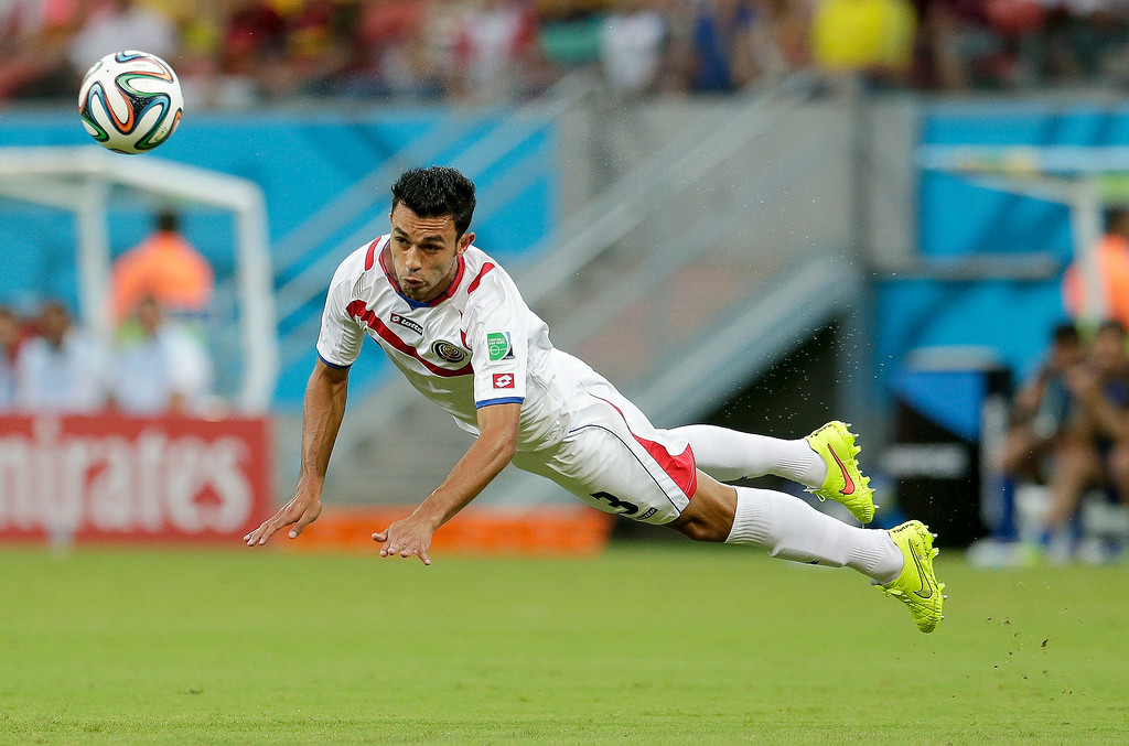 . Costa Rica\'s Giancarlo Gonzalez passes the ball with a header during the World Cup round of 16 soccer match between Costa Rica and Greece at the Arena Pernambuco in Recife, Brazil, Sunday, June 29, 2014. (AP Photo/Petr David Josek)