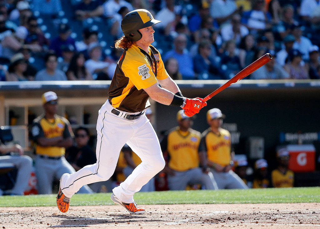 . U.S. Team\'s Clint Frazier, of the Cleveland Indians, follows through on an RBI-base hit during the third inning of the All-Star Futures baseball game against the World Team, Sunday, July 10, 2016, in San Diego. (AP Photo/Lenny Ignelzi)