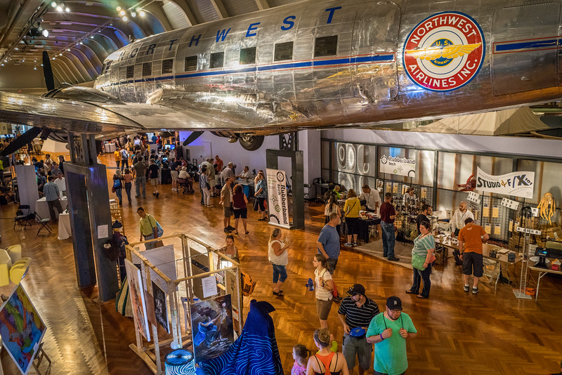Visitors stroll beneath a suspended 1939 Douglas DC-3 at The Henry Ford Museum