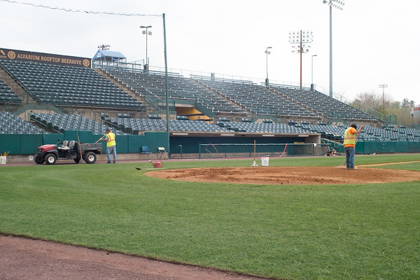 05/02/19 Wesley Bunnell | Staff Work at New Britain Stadium is underway getting the field in shape for Friday's upcoming New Britain Bees home opener. Alberto Vega prepares the area around home plate.