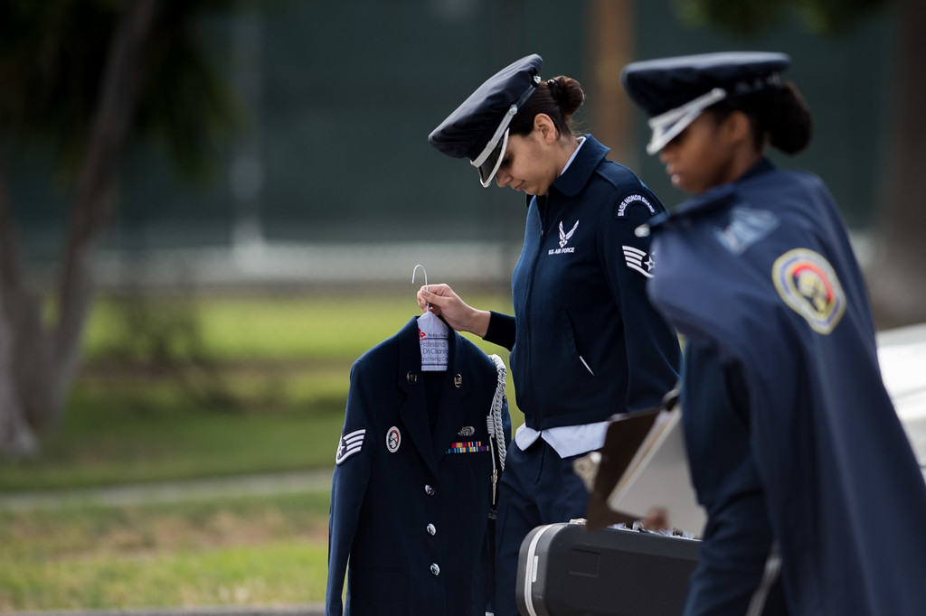 . Staff Sgt. Anahi Ledezma, left, leaves to go to her first funeral ceremony with Staff Sgt. Zakia Webster at March Air Reserve Base in Riverside, Calif. on Monday, May 18, 2015. (Photo by Watchara Phomicinda/ Los Angeles Daily News)