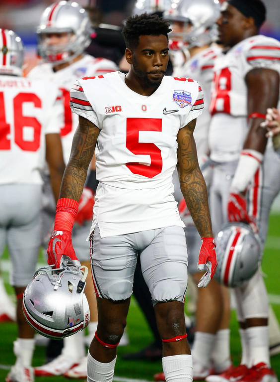 . Ohio State linebacker Raekwon McMillan (5) warms up prior to the Fiesta Bowl NCAA college football game against Clemson, Saturday, Dec. 31, 2016, in Glendale, Ariz. (AP Photo/Ross D. Franklin)