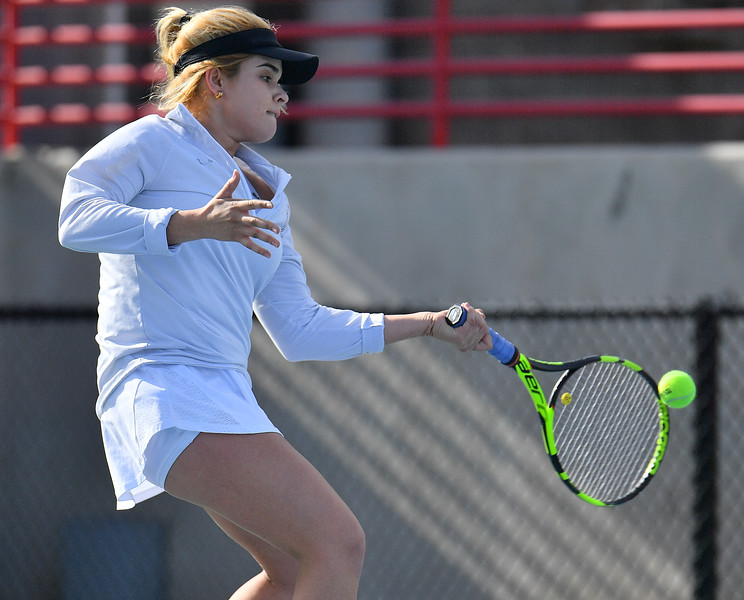 LAS VEGAS, NV - JANUARY 20:  Vanessa Valdez of the New Mexico State Aggies plays a forehand during her match against Caitlin Herb of the Weber State Wildcats at the Frank and Vicki Fertitta Tennis Complex in Las Vegas, Nevada. Herb won the match 6-4, 7-6 (10-5)