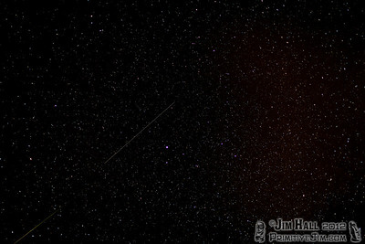 """In the lower left you can see the tailend of a fireball. This one was very bright and colorful, unfortunately it was just out of the frame. A second smaller meteor followed just behind it. The brightest star near the center is Vega in the constellation Lyra.    """"The Lyrid meteor shower consists of remnants of Comet C/1861 G1 (Thatcher). The orbit of this comet appears to lie in the constellation Lyra, close to the border of Hercules; hence these meteors are called the Lyrids."""""""