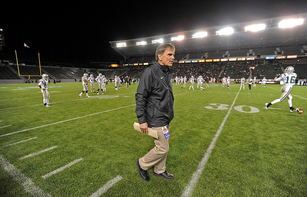 . De La Salle Spartans\' head coach Bob Ladouceur walks along the field before playing the Centennial Huskies in the Open Division during the 2012 CIF State Football Championship at Home Depot Center in Carson , Calif. on Saturday, Dec. 15, 2012. (Jose Carlos Fajardo/Staff)
