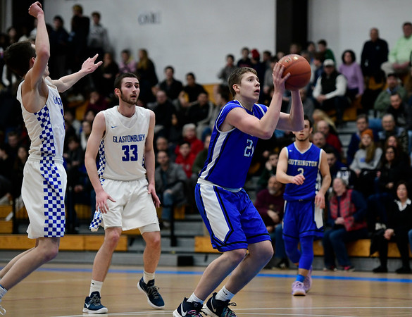 3/6/2019 Mike Orazzi | Staff Southington's William Wadolowski (21) during Wednesday night's Division II Second Round State Boys Basketball Tournament with at Glastonbury High School.