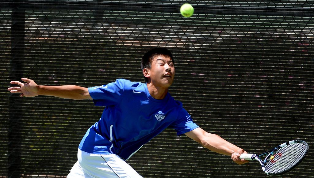 . San Marino\'s Ryan Cheng returns a shot by University\'s (Irvine) Eric Tseng (not pictured) during the CIF State Tennis Championship at the Claremont Club in Claremont, Calif., on Saturday, May 31, 2014. Tseng won 6-3, 6-4.   (Keith Birmingham/Pasadena Star-News)