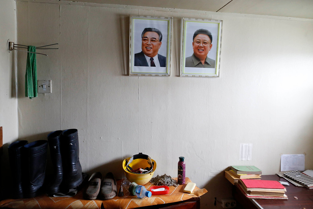 ". Portraits of former leader Kim Jong-il (R) and former president Kim Il-sung are seen in one of the rooms inside a North Korean flagged ship ""Chong Chon Gang\"" docked at the Manzanillo Container Terminal in Colon City July 16, 2013. REUTERS/Carlos Jasso"