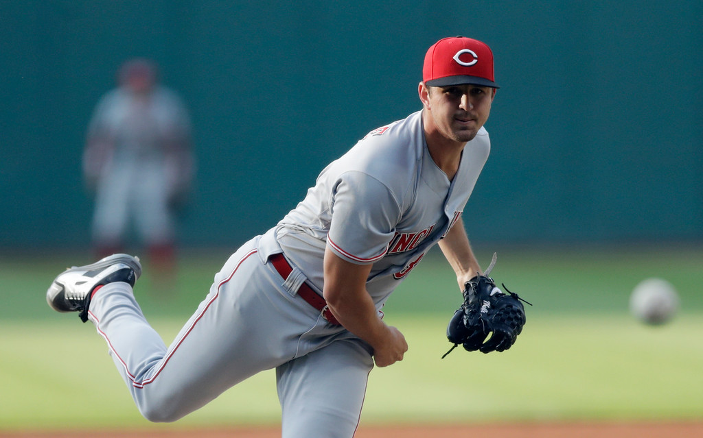 . Cincinnati Reds starter Tyler Mahle watches a pitch during the first inning of the team\'s baseball game against the Cleveland Indians, Wednesday, July 11, 2018, in Cleveland. (AP Photo/Tony Dejak)