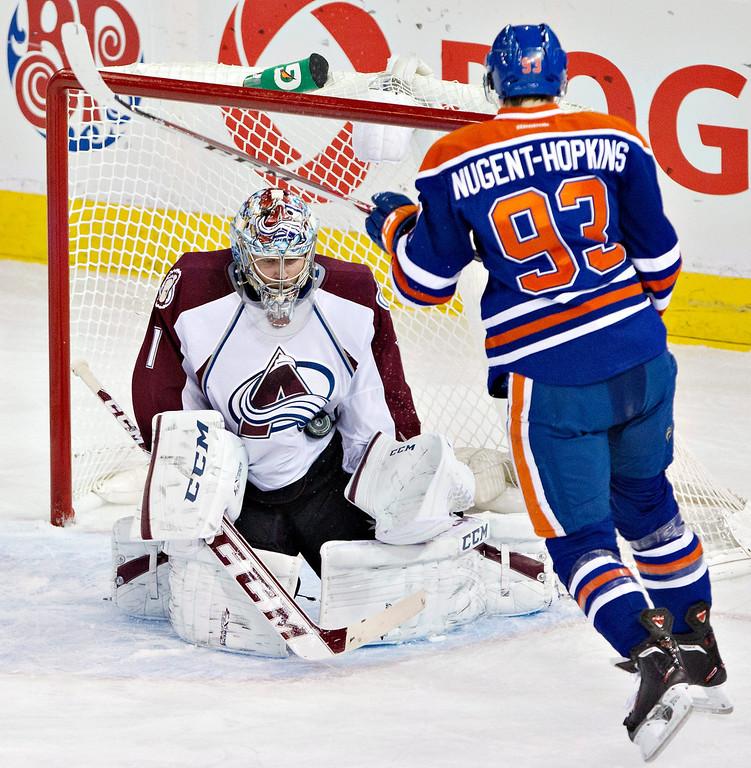 . Colorado Avalanche goalie Semyon Varlamov (1) makes the save on Edmonton Oilers\' Ryan Nugent-Hopkins (93) during second-period NHL hockey game action in Edmonton, Alberta, Thursday, Dec. 5, 2013. (AP Photo/The Canadian Press, Jason Franson)