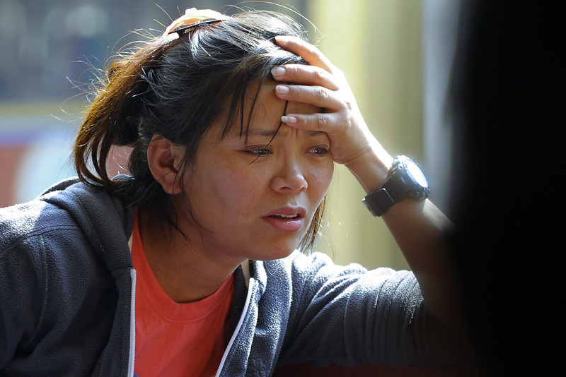 . A relative of a Mount Everest avalanche victim grieves as bodies arrive at the Sherpa Monastery in Kathmandu on April 19, 2014. Rescuers on Mount Everest April 19 found the body of a 13th Nepalese guide buried under snow as authorities ruled out hope of finding any more survivors from the deadliest accident ever on the world\'s highest peak. (PRAKASH MATHEMA/AFP/Getty Images)