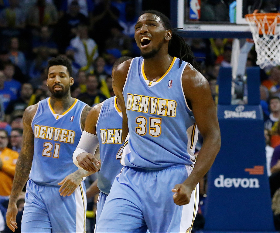 . Denver Nuggets forward Kenneth Faried (35) gestures as he walks off the court during a time out after missing a foul shot against the Oklahoma City Thunder in the fourth quarter of an NBA basketball game in Oklahoma City, Monday, Nov. 18, 2013. Oklahoma City won 115-113. Nuggets forward Wilson Chandler (21) is at left. (AP Photo/Sue Ogrocki)