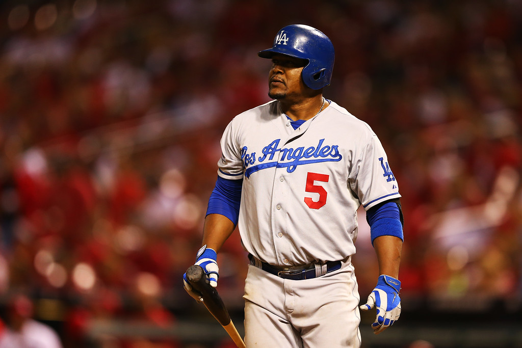 . ST LOUIS, MO - OCTOBER 11:  Juan Uribe #5 of the Los Angeles Dodgers reacts as he strikes out in the 13th inning against the St. Louis Cardinals during Game One of the National League Championship Series at Busch Stadium on October 11, 2013 in St Louis, Missouri.  (Photo by Elsa/Getty Images)