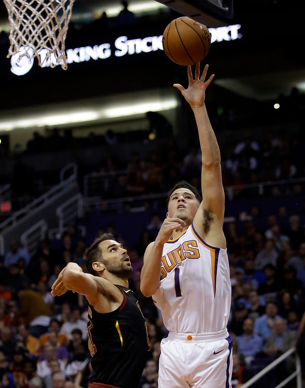 . Phoenix Suns guard Devin Booker (1) in the second half during an NBA basketball game against the Cleveland Cavaliers, Tuesday, March 13, 2018, in Phoenix. The Cavaliers defeated the Suns 129-107. (AP Photo/Rick Scuteri)