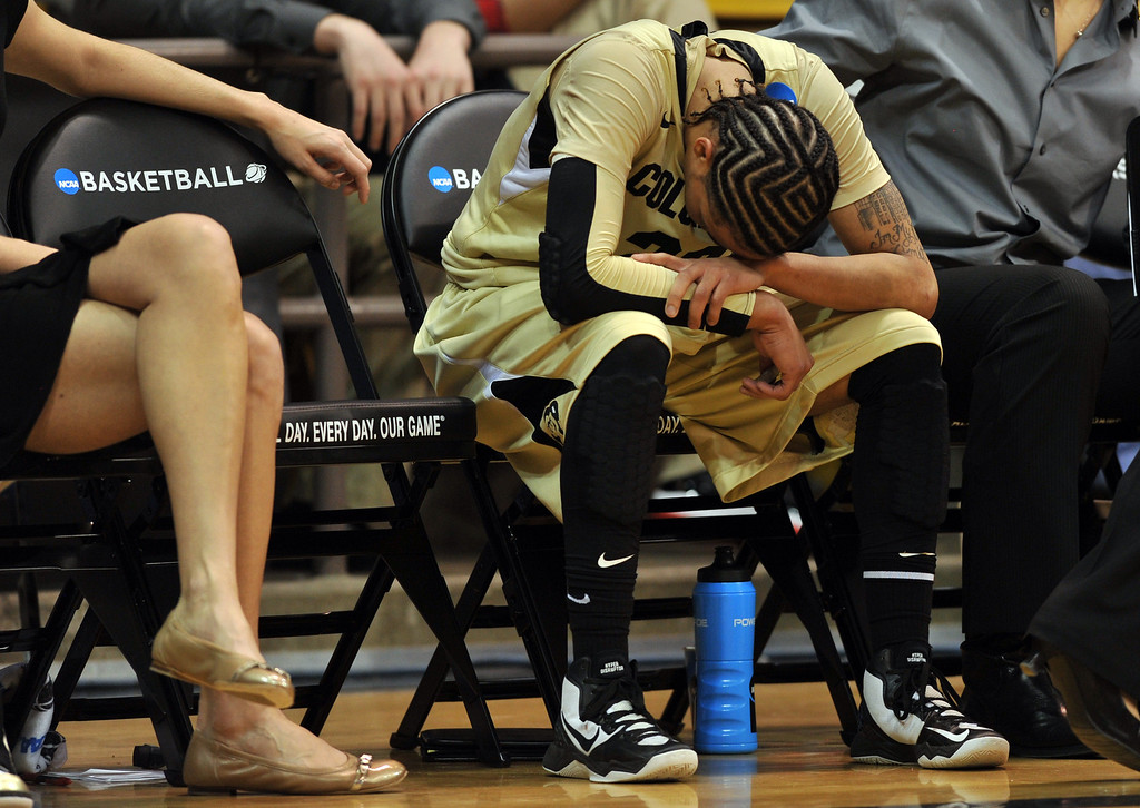 . BOULDER, CO. - MARCH 23: Chucky Jeffery of Colorado Buffaloes (23) heads down at the bench in the end of the first round of the 2013 NCAA women\'s Basketball Tournament against Kansas Jayhawks at Coors Events Center. Boulder, Colorado. March 23, 2013. Kansas won 67-52. (Photo By Hyoung Chang/The Denver Post)