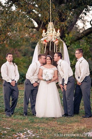 groomsmen farm wedding location with bride.jpg