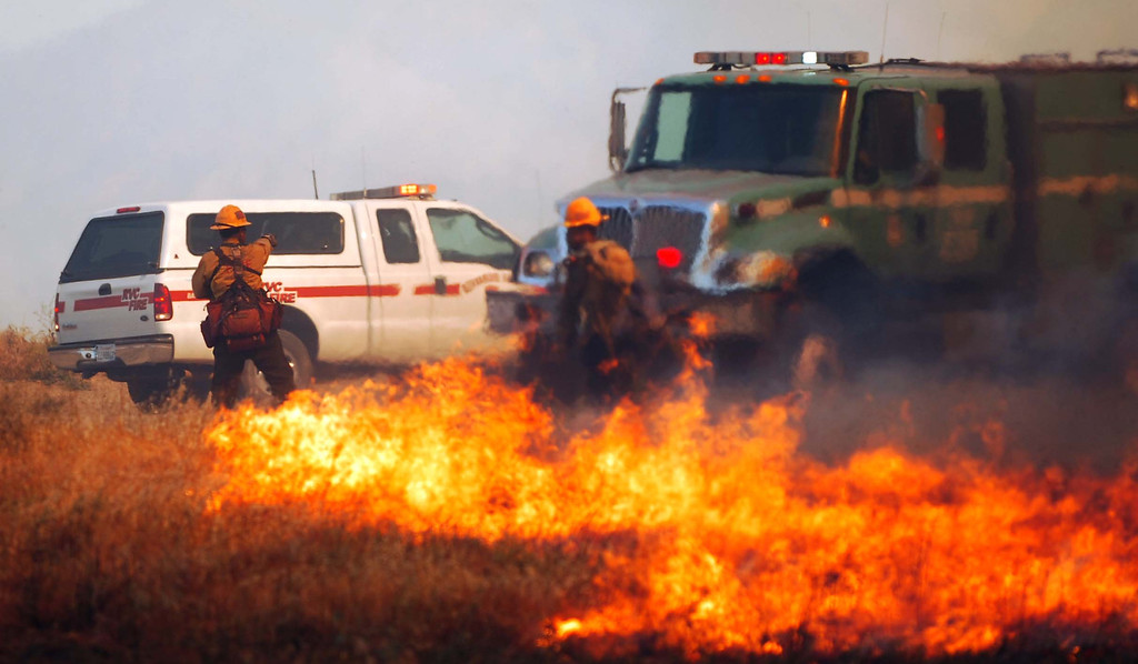 . Firefighters battle flames on a 1,500 acre brush fire Wednesday May 1, 2013 in Banning. LaFonzo Carter/Staff Photographer