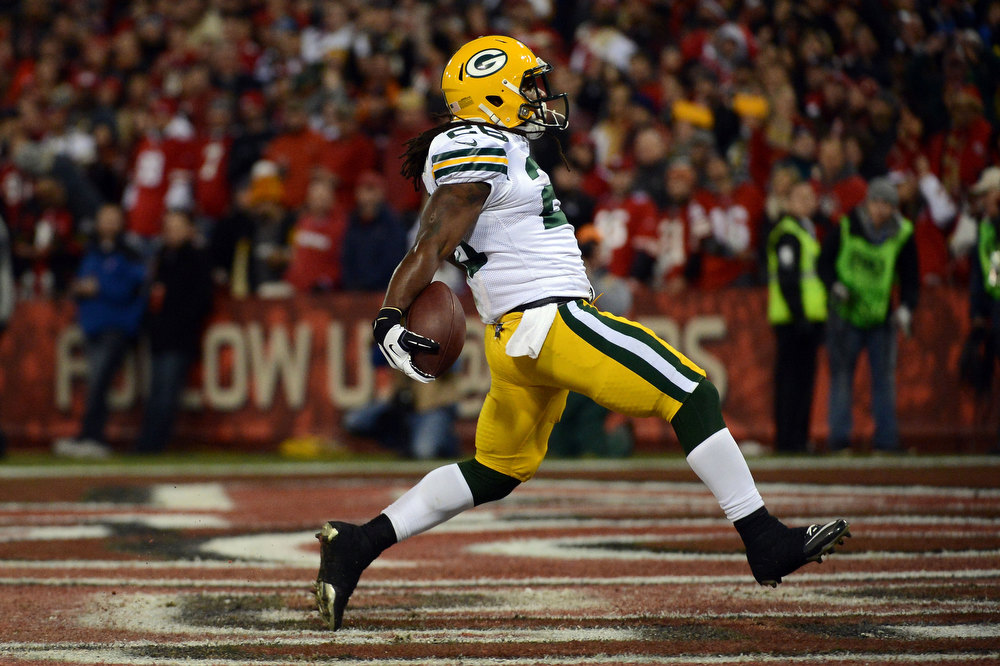 Description of . Running back DuJuan Harris #26 of the Green Bay Packers celebrates after running the ball in for a touchdown against the San Francisco 49ers in the first quarter during the NFC Divisional Playoff Game at Candlestick Park on January 12, 2013 in San Francisco, California.  (Photo by Harry How/Getty Images)