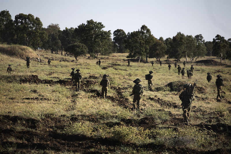 . Israeli infantry soldiers take part in unit exercises in the Israeli annexed Golan Heights near the border with Syria on May 27, 2013. Middle East unrest increases the chance of Israel becoming embroiled in a surprise war, the head of its air force said. MENAHEM KAHANA/AFP/Getty Images