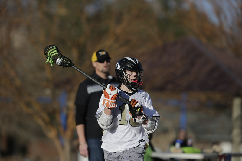 JPM0089-JPM0089-Jonathan first HS lacrosse game March 9th.jpg