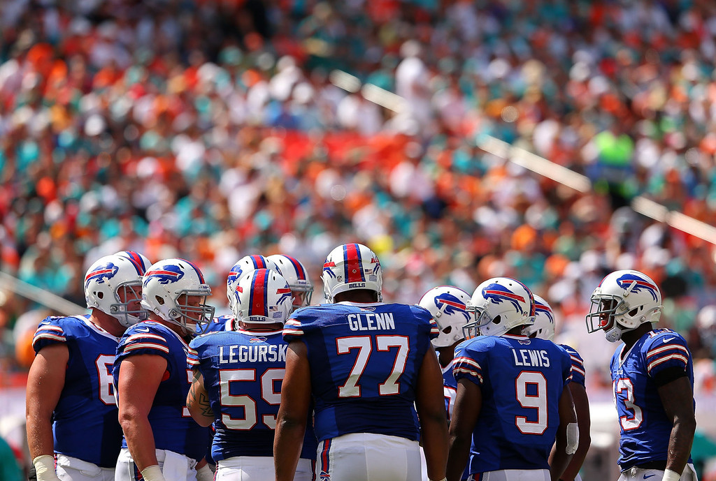 . Thad Lewis #9 of the Buffalo Bills calls a play in the huddle during a game against the Miami Dolphins at Sun Life Stadium on October 20, 2013 in Miami Gardens, Florida.  (Photo by Mike Ehrmann/Getty Images)