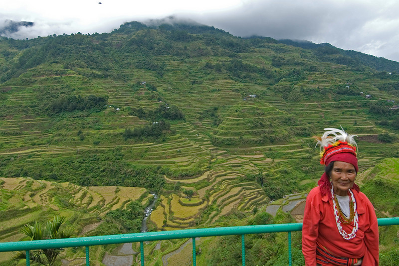 Ifugao woman posing in front of the Banaue Rice Terraces - Banaue, Philippines