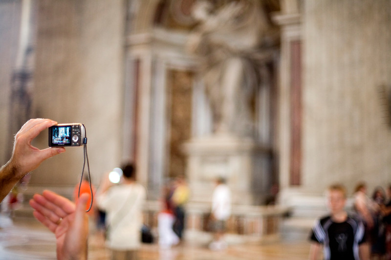 Visitor taking pictures, Saint Peter's basilica, Vatican