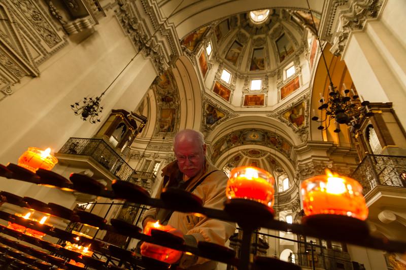 Genevieve Hathaway_Austria_Salzburg_Salzburg Cathedral_lighting candles_2.jpg