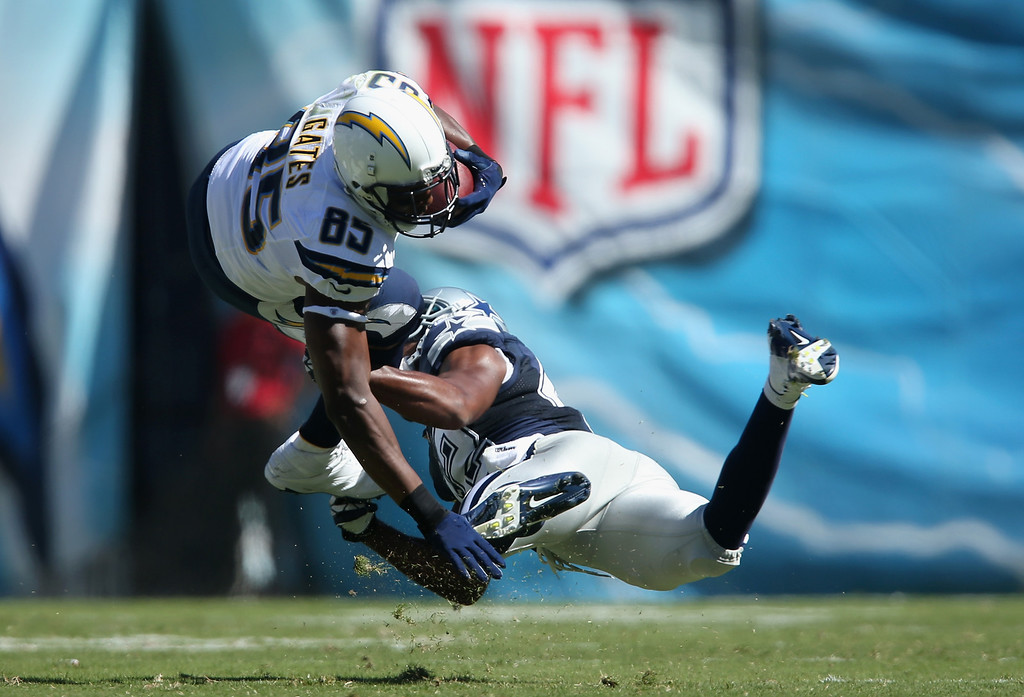 . SAN DIEGO, CA - SEPTEMBER 29:  Tight end Antonio Gates #85 of the San Diego Chargers is tackled by free safety Barry Church #42 of the Dallas Cowboys in the first quarter at Qualcomm Stadium on September 29, 2013 in San Diego, California.  (Photo by Jeff Gross/Getty Images)