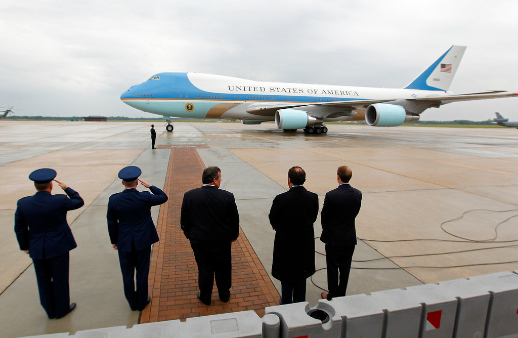 . New. Jersey Gov. Chris Christie, center, and others, await President Barack Obama as Air Force One taxies at McGuire Air Force Base, N.J. Tuesday, May 28, 2013.  (AP Photo/Rich Schultz)