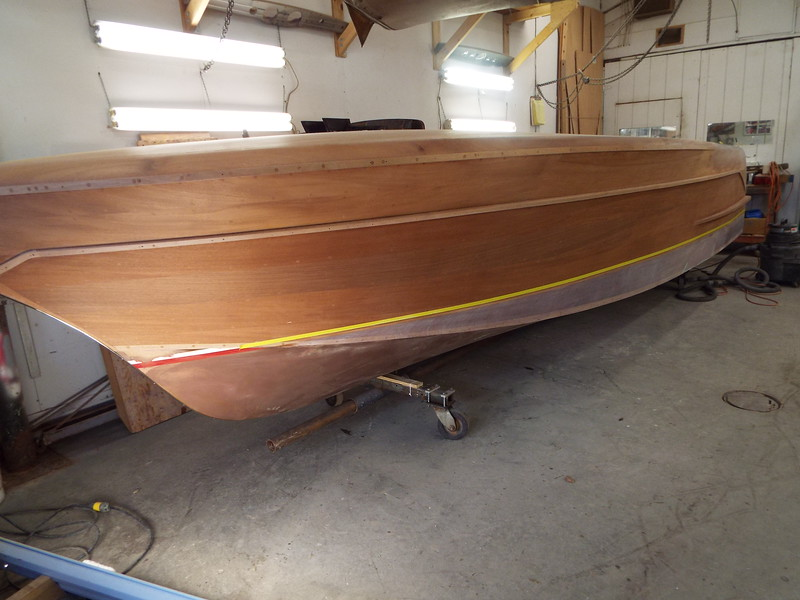 Front port view of the epoxy sanded up to the water line.