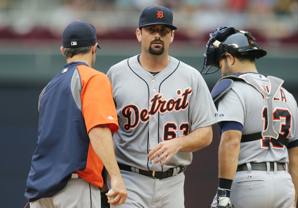 . Detroit Tigers relief pitcher Patrick McCoy is pulled in the third inning of a baseball game against the Minnesota Twins, Saturday,  Aug. 23, 2014, in Minneapolis. (AP Photo/Jim Mone)