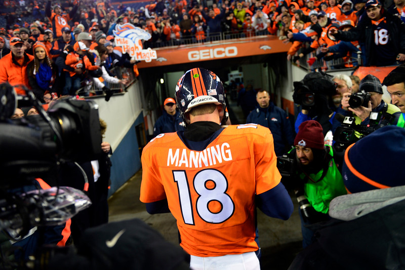 . Peyton Manning (18) of the Denver Broncos walks off the field after losing to the Colts 24 to 13.  The Denver Broncos played the Indianapolis Colts in an AFC divisional playoff game at Sports Authority Field at Mile High in Denver on January 11, 2015. (Photo by Tim Rasmussen/The Denver Post)