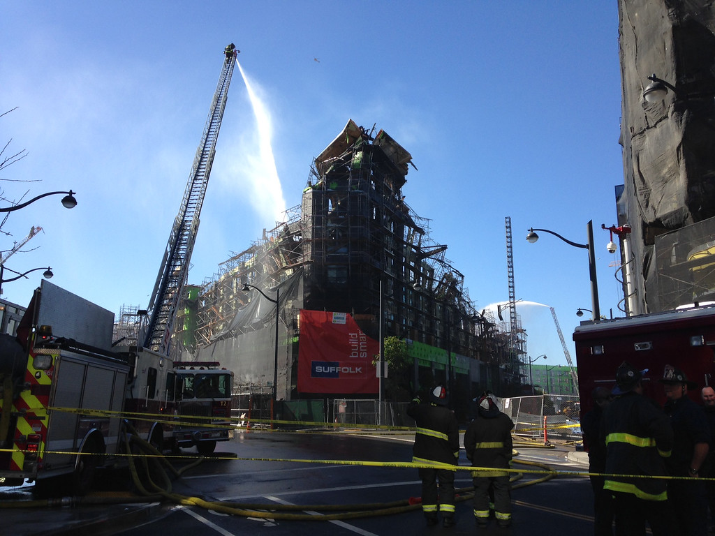 . Firefighters continue to pour water on hotspots the day after a five-alarm fire destroyed an apartment complex in San Francisco\'s Mission Bay area on Wednesday, March 12, 2014. (Laura A. Oda/Bay Area News Group)