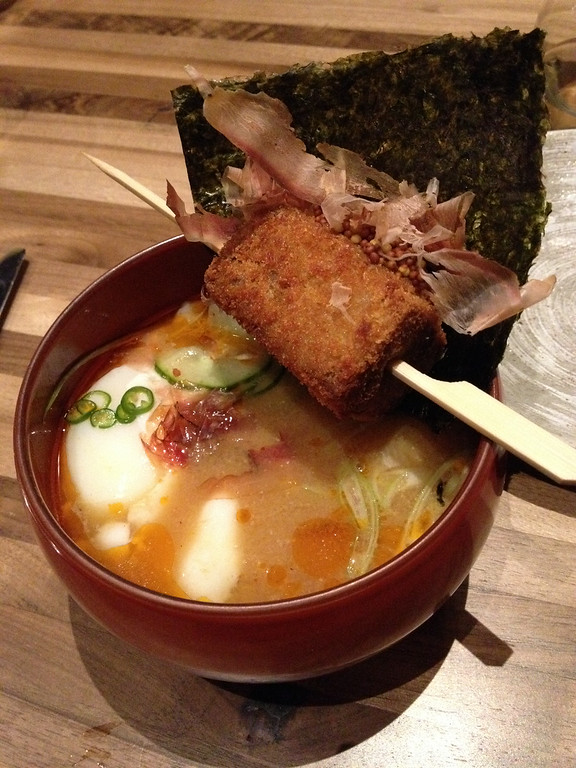 ". Logan ""poser\"" Ramen is a nontraditional take on the noodle bowl, with a crispy pork croquette suspended over the spicy broth. Kyle Wagner, The Denver Post"