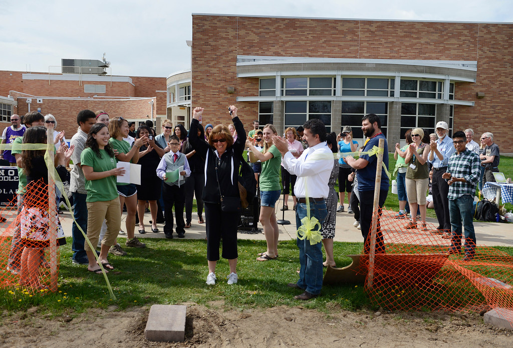 . AURORA, CO. - MAY 18: Nancy Edmonds celebrates after cutting the ribbon during the North Middle School Garden Festival in Aurora, CO May 18, 2013. Edmonds is a member of the community garden committee. The celebration marked the opening of the first school-based community garden in Aurora Public Schools. The project, funded by The Piton Foundation, was made possible through a partnership of Aurora Public Schools, Denver Urban Gardens (DUG), and Anschutz Medical Campus Department of Family Medicine and BRANCH, a multi-disciplinary student organization from the medical campus. A second garden is scheduled to open later this year at Hinkley High School. (Photo By Craig F. Walker/The Denver Post)