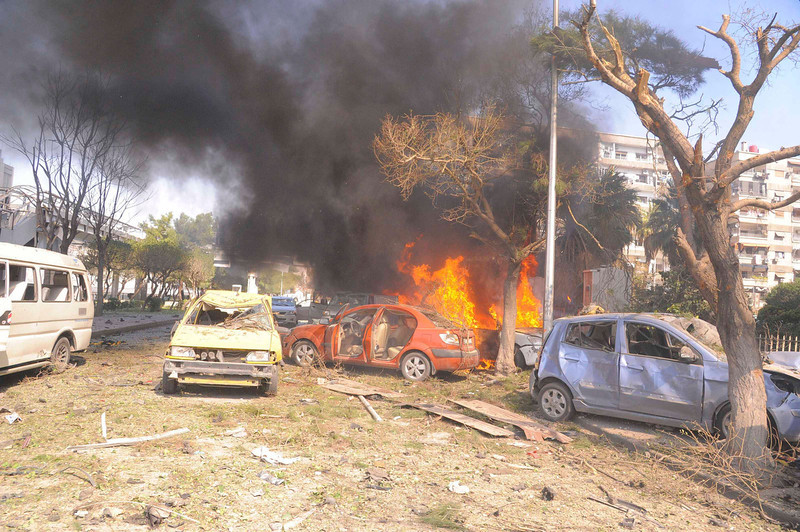 ". Vehicles burn after an explosion at central Damascus February 21, 2013, in this handout photograph released by Syria\'s national news agency SANA. The big explosion shook the central Damascus district of Mazraa on Thursday, residents said, and Syrian state media blamed what it said was a suicide bombing on ""terrorists\"" battling President Bashar al-Assad. Syrian television broadcast footage of at least four bodies strewn along a main street and firefighters dousing the charred remains of dozens of burning vehicles. Black smoke billowed into the sky.  REUTERS/Sana"
