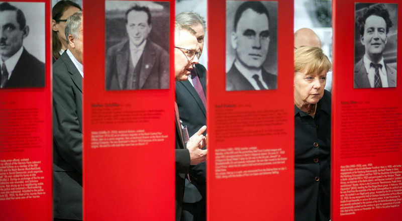 . In this photo provided by the German government German Chancellor Angela Merkel, left, visits the special exhibition \'Berlin 1933 - the way to despotism\' at the Topography of Terror museum in Berlin, Germany, Wednesday, Jan. 30, 2013. The Topography of Terror museum is located at the area where the headquarters of the Gestapo and SS were destroyed by allied bombing. (AP Photo/German Government, Guido Bergmann)