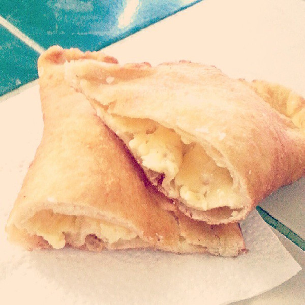 While_I_don_t_usually_eat_deep_fried_food_I_can_t_pass_up_empanadas_de_viento._Served_in_the_afternoon_the_name_literally_means_wind_empanadas_because_they_are_full_of_air_and_in_this_case_filled_with_a_bit_of_queso_for_only_sixty_cents..jpg