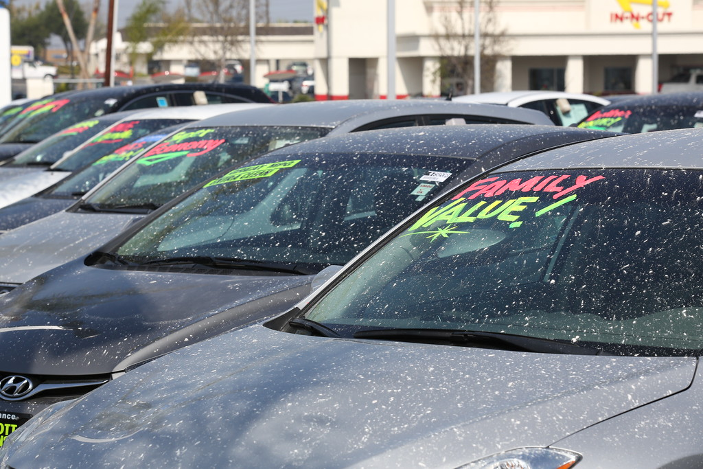 . A thick layer of ash covers the cars at Scott Robinson Honda on Hawthorne Blvd Wednesday following the explosion at the Exxon/Mobil refinery in Torrance. (Chuck Bennett/Daily Breeze)