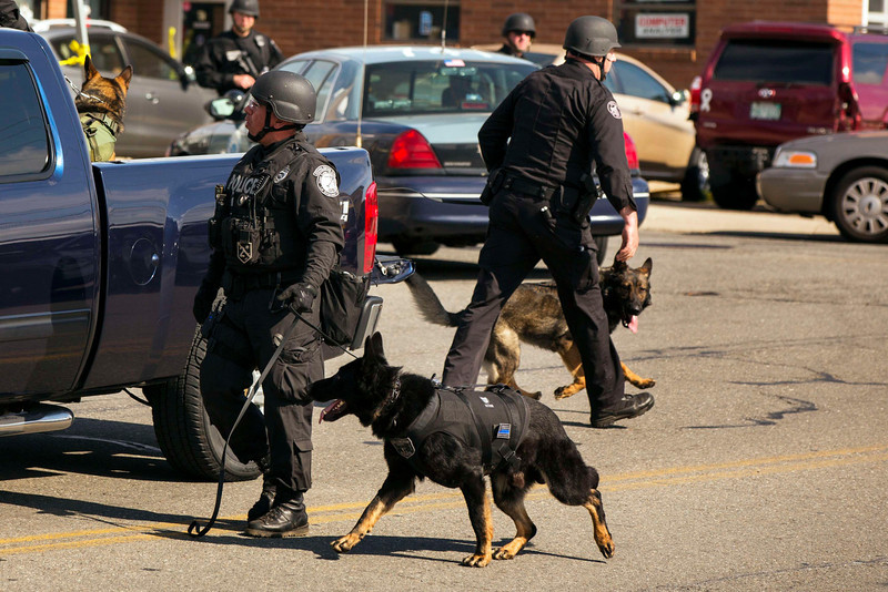 . Law enforcement officials depart with their K-9 units during the search for a suspect in the Boston Marathon bombing in Watertown, Massachusetts April 19, 2013. Police killed one suspect in the Boston Marathon bombing, Tamerlan Tsarneav, in a shootout and mounted house-to-house searches for the second man, his brother Dzhokar Tsarnaev, on Friday, with much of the city under virtual lockdown after a bloody night of shooting and explosions in the streets.       REUTERS/Lucas Jackson